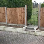 Closeboard panels, erected in slotted posts.