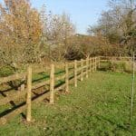Softwood post and rail fencing.