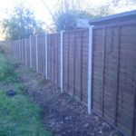 'B' grade larch panels, erected on concrete slotted posts.