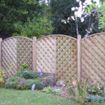 Suffolk fence panels, erected on wooden posts.