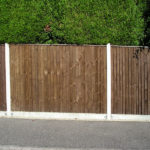Closeboard fencing, erected on concrete morticed posts, with 150mm concrete gravel board.