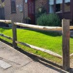 Chestnut cleft post and rail fencing.